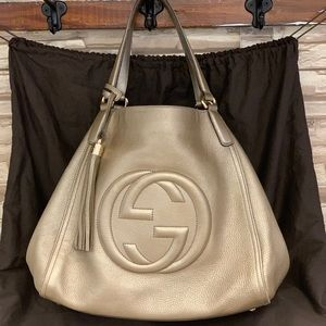 BARELY USED. PRISTINE CONDITION Gucci Gold Bag